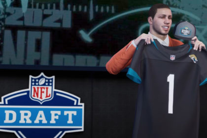 Holding up the number one draft pick shirt